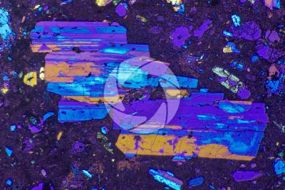 Lava with Cordierite. Lipari. Aeolian islands. Sicily. Thin section in cross polarized light with lambda filter. 32X