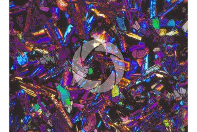 Gabbro. Costa Rica. Sezione sottile in luce polarizzata a Nicol incrociati con filtro lambda. 32X