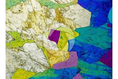 Pegmatite. Thin section in cross polarized light with lambda filter. 32X