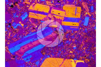 Conglomerate. Thin section in cross polarized light with lambda filter. 32X
