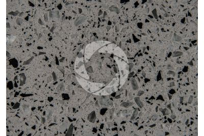 Artificial agglomerated stone. White Platinum. Polished section. 1X