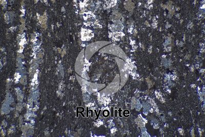 Rhyolite. Thin section in cross polarized light. 32X