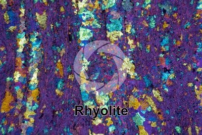 Rhyolite. Thin section in cross polarized light with lambda filter. 32X