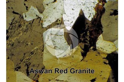 Aswan Red Granite. Egypt. Thin section in cross polarized light. 32X