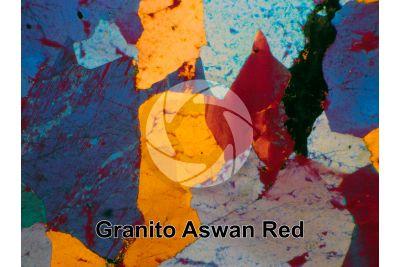 Granito Aswan Red. Egitto. Sezione sottile in luce polarizzata a Nicol incrociati con filtro lambda. 32X