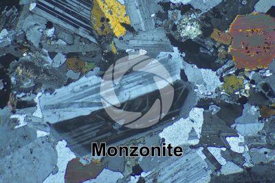 Monzonite. Sezione sottile in luce polarizzata a Nicol incrociati. 32X