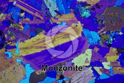 Monzonite. Sezione sottile in luce polarizzata a Nicol incrociati con filtro lambda. 32X