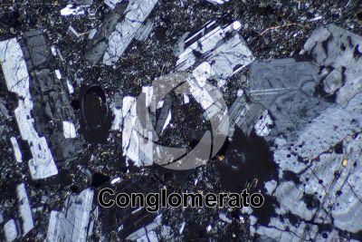 Conglomerato. Sezione sottile in luce polarizzata a Nicol incrociati. 32X