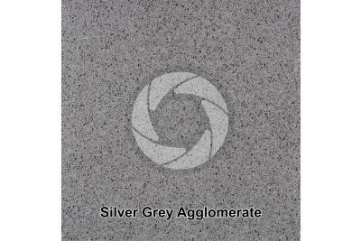 Artificial agglomerated stone. Silver Grey. Polished section. 1X