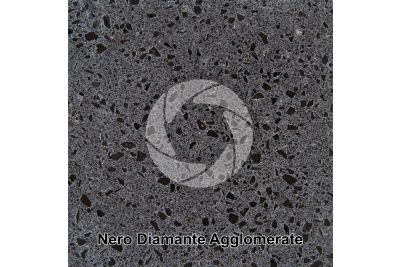 Artificial agglomerated stone. Nero Diamante. Polished section. 1X