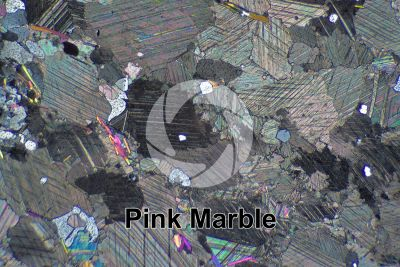 Pink Marble. Austria. Thin section in cross polarized light. 32X